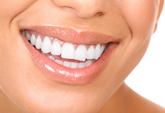 Smiling woman representing quality dental work in Barnegat, Manahawkin and Ocean County
